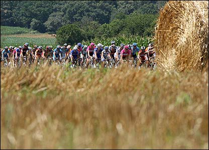 The Tour heads past straw bales