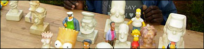 The Simpson carvings alongside plastic models of the characters