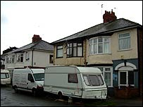 Caravans and builders' trucks line the streets of Hull