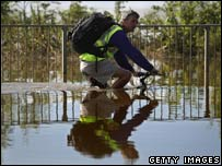 A cyclist navigates the floods in Tewkesbury