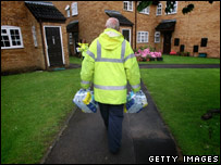 A council worker delivering bottles of water in Gloucester
