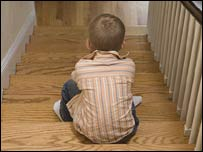 Unidentified child sitting on stairs