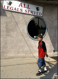 A boy walks past the Roads End bar on Broad Street in Hazleton