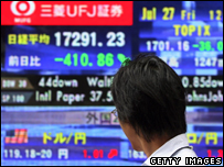 Man looks at stock market figures in Tokyo