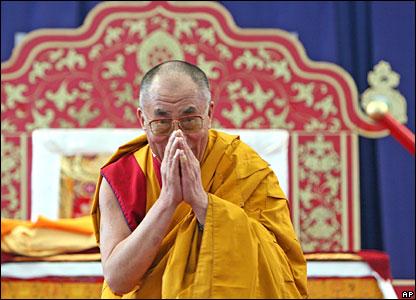 Tibetan spiritual leader the Dalai Lama greets guests during a lecture in Hamburg, Germany.