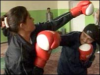 Women practice boxing