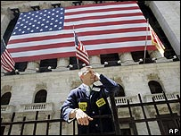 Market trader below US flag
