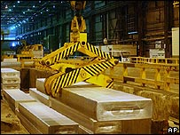 Aluminium ingot being processed at factory of US firm Alcoa