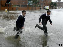 Pupils in flood water