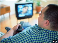 Man watching television. File photo