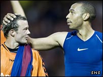 Noel Hunt is gifted a Barcelona shirt by Thierry Henry on Wednesday