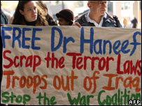 Activists hold a banner outside the Immigration Department in Sydney, 18 July 2007, calling for the release of Dr Haneef
