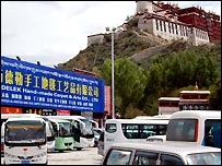 Carpet shop and tour buses below Potala Palace