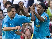 Ronaldinho celebrates his opening penalty goal