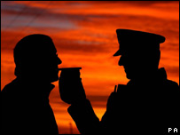 A policeman testing a man for alcohol levels