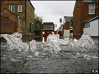Water gushes from a manhole in the Osney area of Oxford