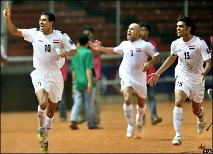 Iraq's captain Younis Mahmoud (left) celebrates with team-mates after scoring a goal against Saudi Arabia during the final match of the Asian Football Cup 2007