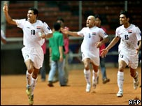 Iraq's captain Younis Mahmoud (left) celebrates with team mates