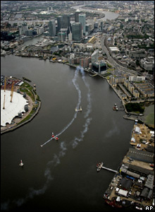 A plane flying over the Thames