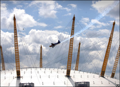 A stunt plane over the O2 Dome in London