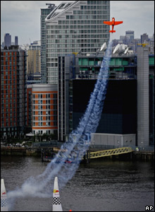 A stunt plane over London's River Thames