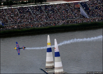 A stunt plane over the River Thames in London
