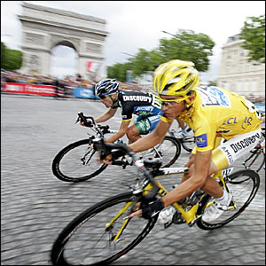 Race leader Alberto Contador on the Champs-Elysees in front of the Arc de Triomphe