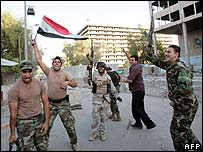 Iraqi soldiers celebrate in Baghdad