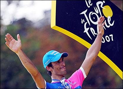 Daniele Bennati celebrates winning the final stage of the Tour de France