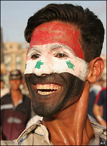 Man with Iraqi flag painted on face in Karbala, Iraq.