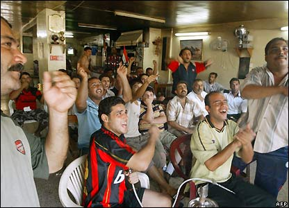 Fans at a cafe in Baghdad
