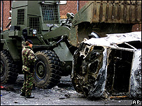 A soldier clears up after a loyalist riot