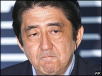 Japanese Prime Minister Shinzo Abe reacts after learning the result of the upper house elections