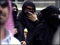 A woman eats an ice cream in Mecca, Saudi Arabia