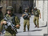 Israeli soldiers patrolling the streets of Hebron, in the West Bank, last September