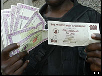 Zimbabwe dollar bills and bearer cheques