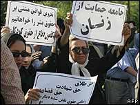 Iranian women hold up banners calling for equal rights - June 2006
