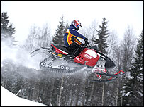 Heikki Kovalainen on a Skidoo in northern Finland