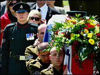 Corporal Will Rigby follows the coffin at the funeral of his twin Corporal John Rigby