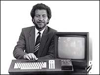 Alan Sugar with an early Amstrad computer