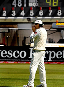Captain Michael Vaughan in front of the scoreboard confirming England's impending defeat