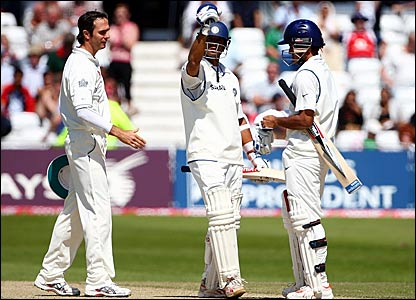 England captain Michael Vaughan offers his hand