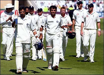 Rahul Dravid  and Sourav Ganguly lead the players off the field
