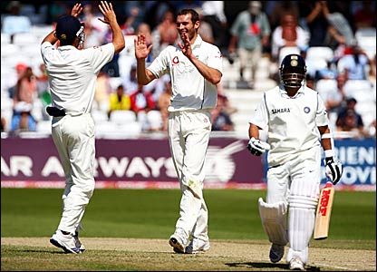 Alastair Cook and Chris Tremlett (left) celebrate the dismissal of Sachin Tendulkar (right)