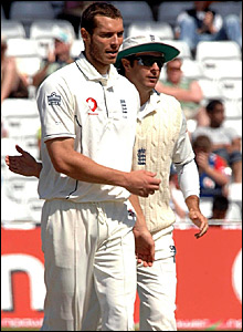 Chris Tremlett (left) is congratulated by Michael Vaughan after dismissing Wasim Jaffer