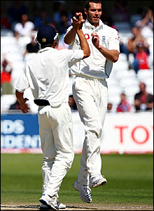 Chris Tremlett (right) celebrates taking his second wicket of India's second innings
