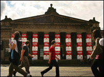 Campbell's soup cans wrapped around the columns of the Royal Scottish Academy