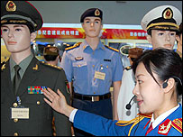 Tour guide shows the PLA's new uniforms at the 80th anniversary exhibition