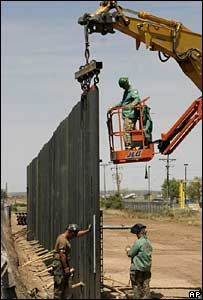 US Army personnel install sections of the US-Mexico border fence July 2007 near Puerto Palomas Mexico.