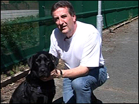 Monty with new owner RSPCA Insp Dave McCartney